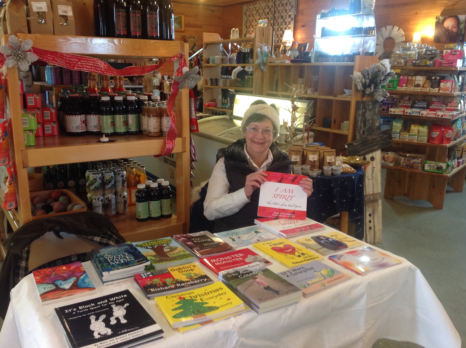 Books Make Booms brand building book table manned by author and illustrator Mary Rensberry.
