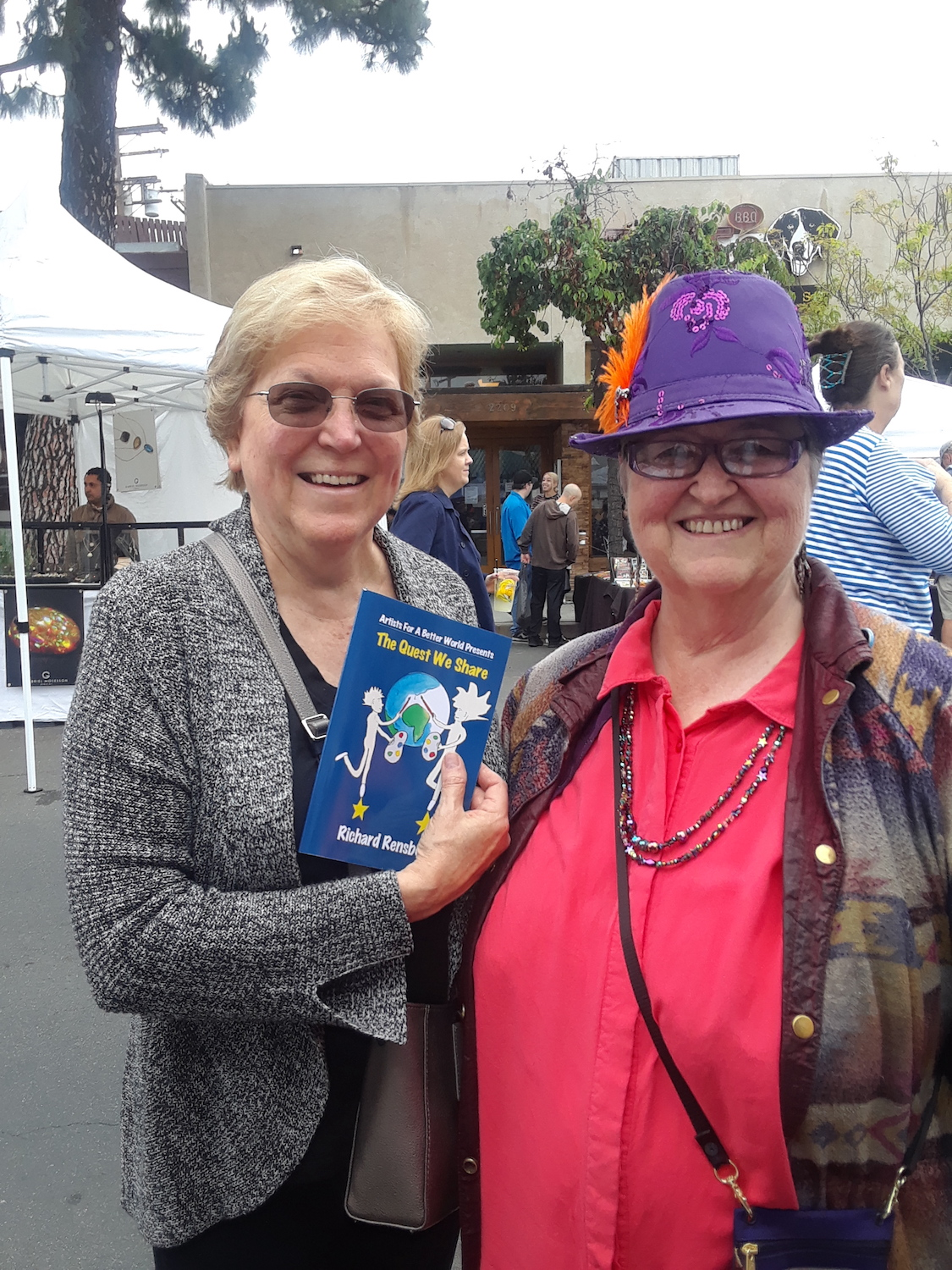 Books Make Booms Custom book- The Quest We Share at an Artists For A Better World event in Los Angeles, California.