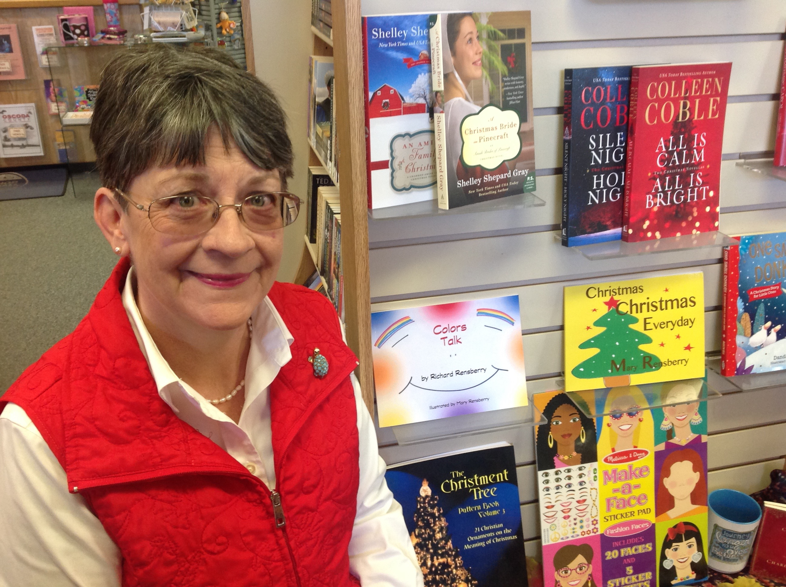 Books Make booms author and illustrator Mary Rensberry displaying custom books created for Small Business Marketing.